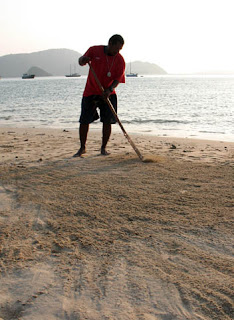 Sweeping the sand at The Beach Bar
