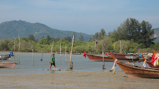 Fisherman and longtail boats