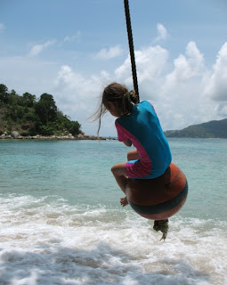 Swinging at Paradise beach