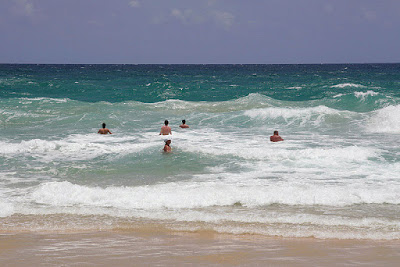 People playing in the waves at Karon Beach