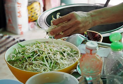 Adding veggies and beansprouts