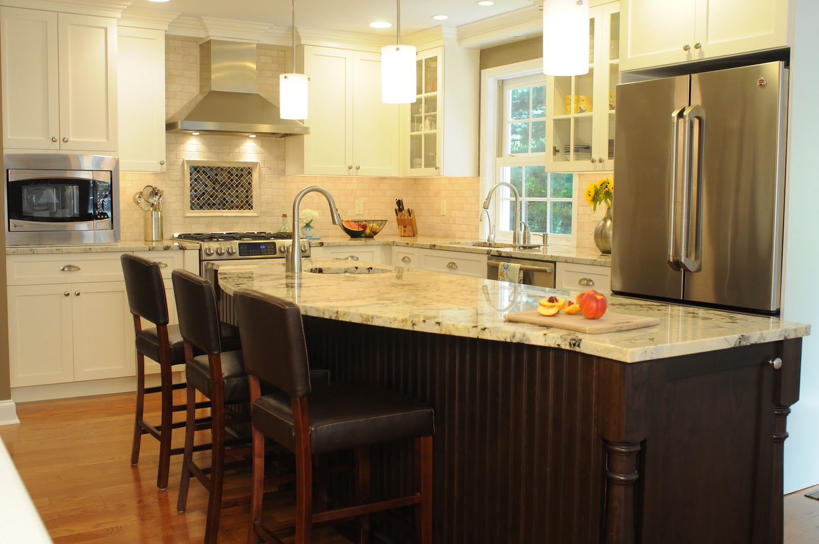 A clean crisp kitchen redo becomes the heart of the home for Kitchen island cabinets