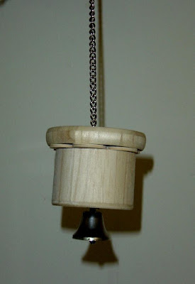 Home made foraging toy, wood, chain, bell
