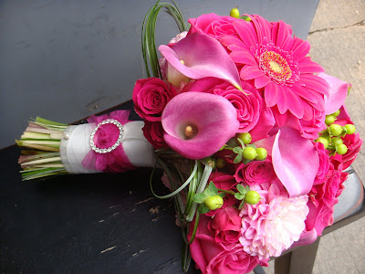 Bridal bouquet composed of Ravel roses, hot pink mini callas, dahlias,