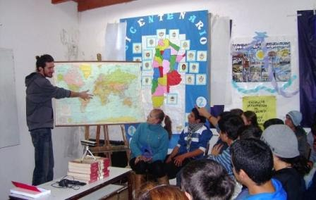 Acrobat of the Road showing students a map