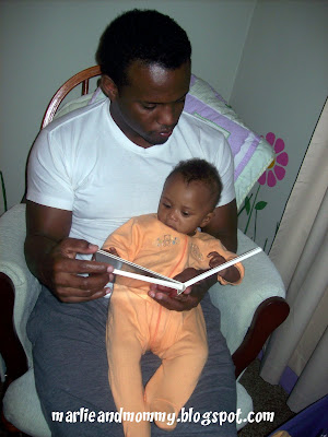 daddy reads to baby Marlie
