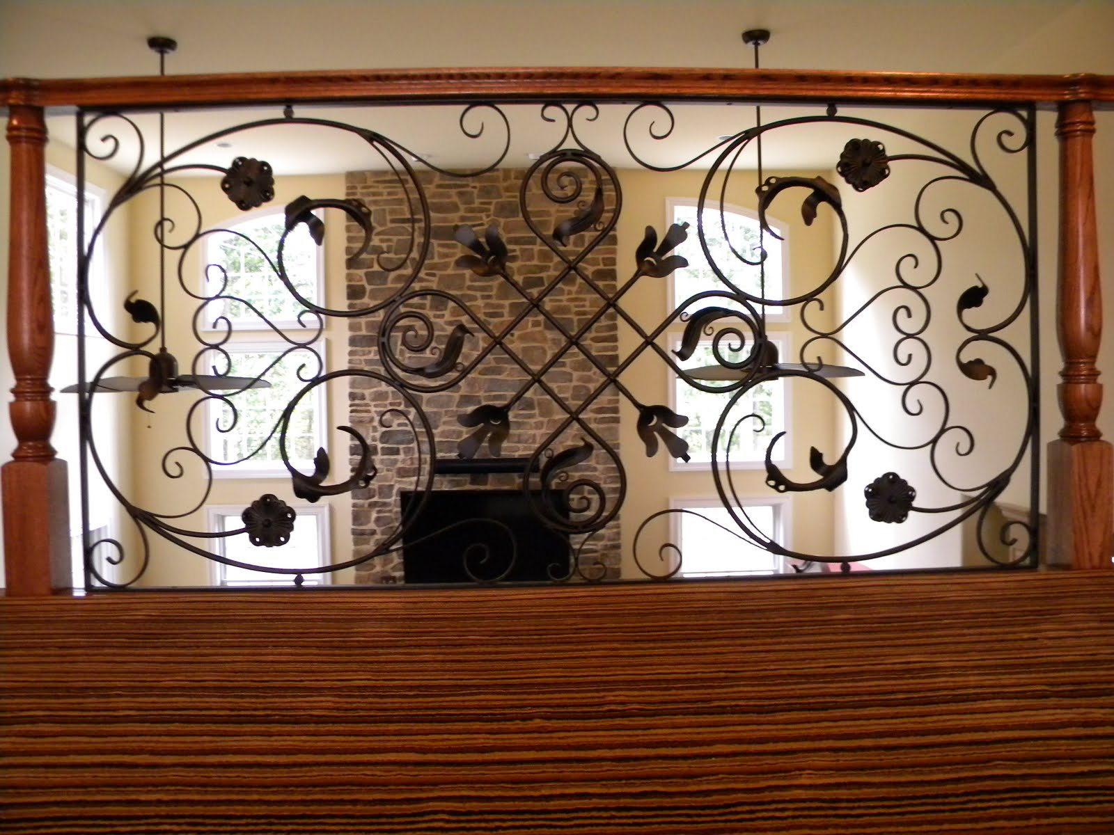 Ornamental railing panels - As You Can See This Decorative Panel Is Used As The Focal Point Of This Balcony Rail Overlooking The Family Room