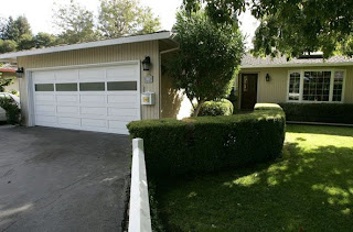 The home where Google co-founders Larry Page and Sergey Brin rented the garage in 1998 to set up Google in Menlo Park, California. Reportedly, Google purchased the 1,900 square foot house where they used to rent out the garage from Susan Wojcicki for $1,700 (£961) a month Photograph: Justin Sullivan/Getty Images