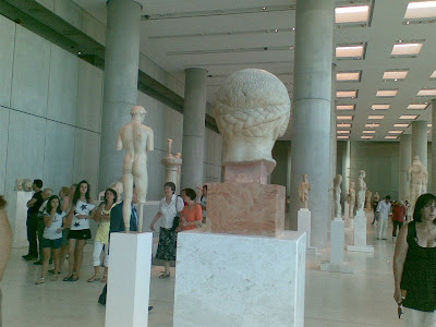Image of the back of the Blonde Boy's head and the back of the Kritios boy