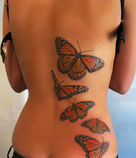 butterfly tattoo lower back women sexy girls.