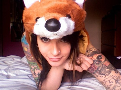 Cute Girl with Tattooed Arms in an Adorable Bear Hat