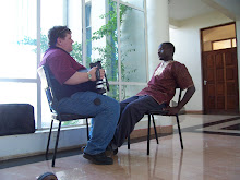 talking with Fidel at the Africa Nazarene University, Kenya
