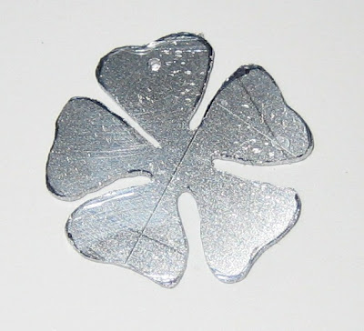 flower cut from aluminium by surf jewels handmade jewellery