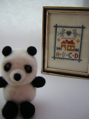 felted panda blury