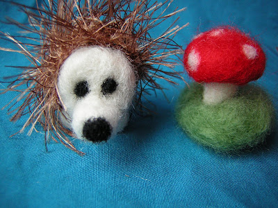 mushroom and hedgehog side by side