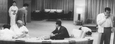 Tatsuya Nakadai (second from right, seated) and Toshir Mifune in High and Low