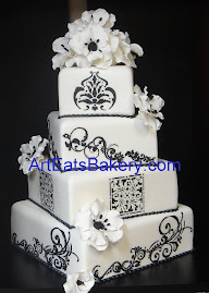Four tier square white fondant wedding cake