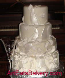 Four tier white fondant wedding cake