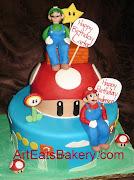 . brothers birthday cakes with fondant figures mario, luigi, fireflower, .