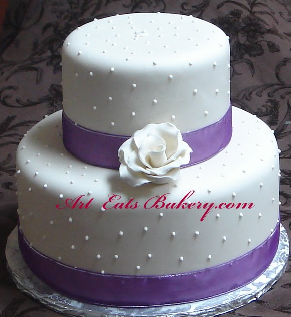 Two tier ivory wedding cake with royal icing dots and hand crafted ...