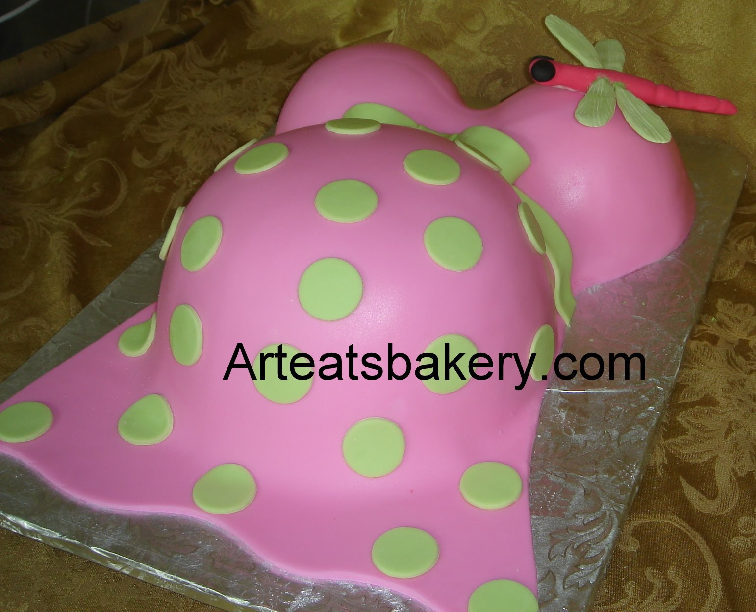 Maternity top in pink fondant with green polka dots and ribbon tied in ...