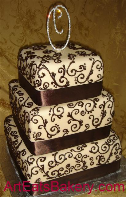 Three tier square ivory fondant custom wedding cake with elegant chocolate