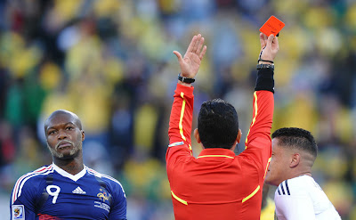 France's striker Djibril Cisse reacts as Colombian referee Oscar Ruiz gives
