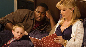 Jae Head, Quinton Aaron y Sandra Bullock en The Blind Side. Un sueño posible