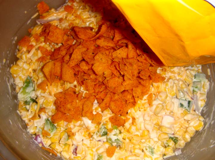 Corn chips in the bag with your hands pour and cover the creamy salad