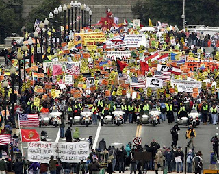 Demonstrators opposed to the Iraq war march across the Memorial Bridge in Washington, D.C.(J. David Ake / Associated Press)Mar 17,2007