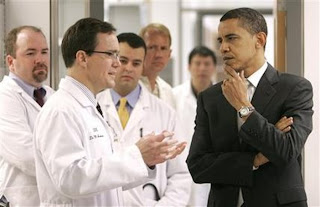 Democratic presidential hopeful U.S. Sen. Barack Obama, D-Ill., talks with Dr. Mark Anderson while touring a cardiology research lab before speaking about his health care plan, Tuesday, May 29, 2007, at the University of Iowa in Iowa City, Iowa. Obama on Tuesday unveiled a health care plan that he contends would extend coverage to all Americans and save consumers $2,500 a year. That cost would be divvied up between businesses, consumers and the government, with much of the amount raised by repealing tax cuts to the wealthy. (AP Photo/Charlie Neibergall)