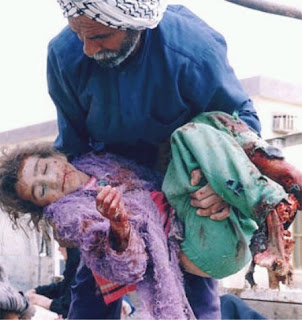 "Iraqi girl killed during the ""Shock and Awe"" campaign in 2003. This picture could be used to accurately depict what is going on in ""Afghanistan"" today."