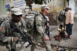 "Members of the 82nd Airborne Division of the ""U.S."" Army patrolling the streets of Port Au Prince, January 19, 2010"