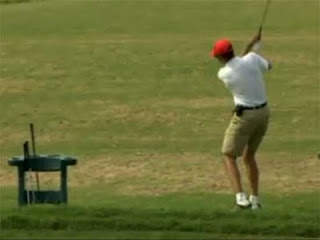 Obama swinging a golf club