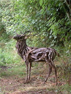 wooden gazelle sculpture