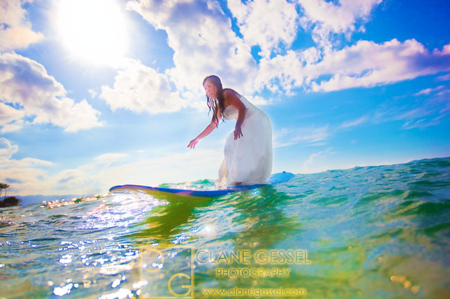trash the dress photo, surfing in wedding dress