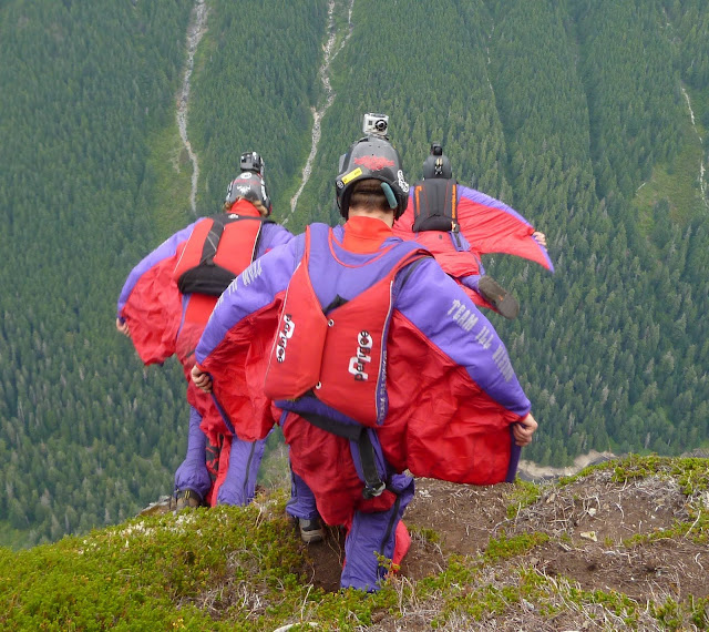 Dingo, Jimmy and Brian exiting with their wingsuits