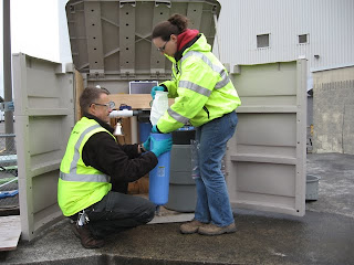 Collecting stormwater samples in the North Boeing Field area