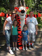 We had to get a family Picture with Tigger.he is my favorite! (disney land kaydens day )