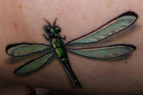 Dragonfly tattoo designs can often be given a stark tribal look,
