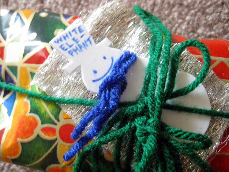 blogger white elephant/potluck gift, tiny snowman with tiny scarf and hairy silver fabric