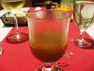 Glass of rasam at Samudra Chennai