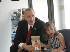 Chloe presents an autographed copy of book to her US Congressman Tim Murphy