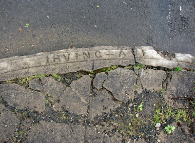 Street name stamped in the corner at Irving and 11th Streets, Astoria, Oregon