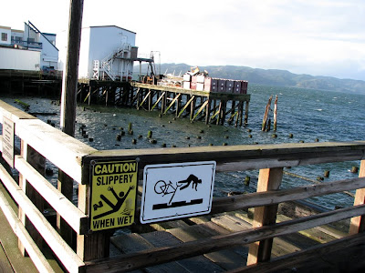 Slippery When Wet and Bicycle Safety Sign at Pier 11, Astoria, Oregon
