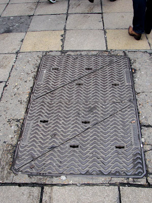 A manhole cover on Oxford Street, London