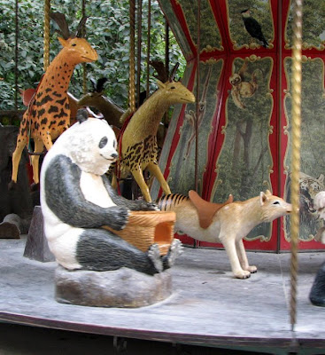 Giant panda and thylacine on the dodo carousel