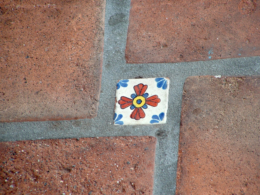 paving bricks and flowered tile