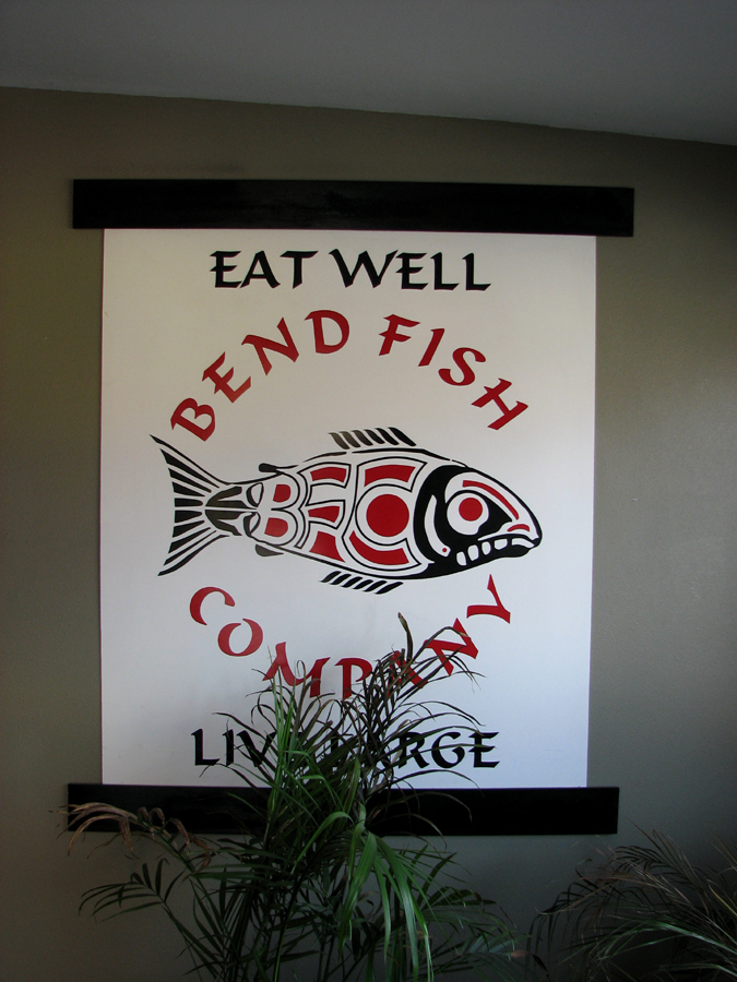 Native American style salmon logo at Bend Fish Company