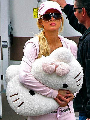 paris hilton holding hello kitty pillow